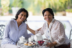 Portrait of woman having breakfast with mother Royalty Free Stock Photography