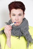 Portrait of woman having a cold with thermometer Royalty Free Stock Photography