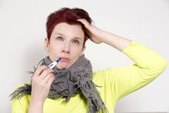 Portrait of woman having a cold with thermometer Stock Photography