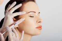 Portrait of woman having cosmetic botox injection Royalty Free Stock Photo