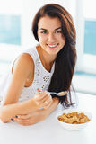 Portrait of woman having healthy breakfast and smiling at the ca royalty free stock photos