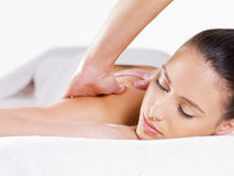 Portrait of woman having massage Stock Image