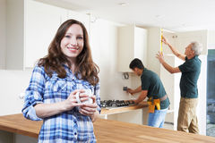 Portrait Of Woman Having New Kitchen Fitted Stock Photo
