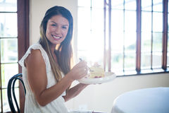 Portrait of woman having a pastry in restaurant Stock Image