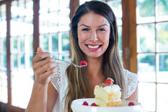 Portrait of woman having a pastry in restaurant Royalty Free Stock Photo