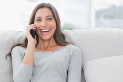 Portrait of a woman having a phone conversation Stock Photos