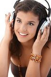 Portrait of woman with headphones smiling Royalty Free Stock Photos