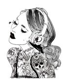 Woman with headphones and tattoo stock photos