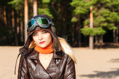Portrait of a woman in helmet of the pilot on a sunny day Stock Image