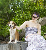 Portrait of a woman with her beautiful dog Stock Photography