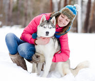 Portrait of a woman with her beautiful dog sitting Stock Photo