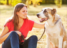 Portrait of a woman with her dog Royalty Free Stock Photo