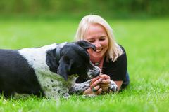 Portrait of a woman with her dog on the meadow Stock Photography