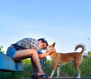 Portrait of A Woman with her dog is playing on the grass field ,they look very happy and funny. A Portrait of Woman with her dog playing on the field ,they are Royalty Free Stock Photos