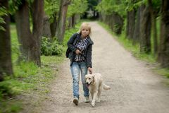 Portrait of woman with her ​​dog on walk Royalty Free Stock Photo