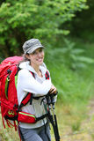Portrait of woman hiker in forest Stock Photography