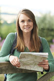Portrait Of Woman Hiking In Countryside Looking At Map Stock Photography