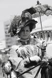 Portrait of a woman in historical costume. She holds an umbrella. Royalty Free Stock Photo