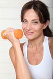 Portrait of woman holdind weight Stock Image