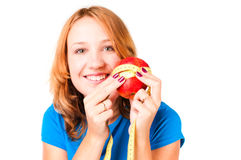 Portrait of a woman holding apple and tape Royalty Free Stock Photo