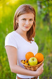 Portrait of woman holding basket Royalty Free Stock Images