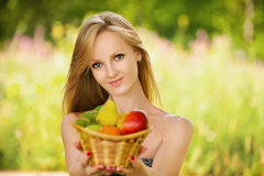 Portrait of  woman holding a basket Stock Photography