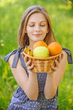 Portrait of woman holding basket with fruits Royalty Free Stock Photo