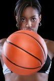 Portrait of woman holding basketball Stock Photo