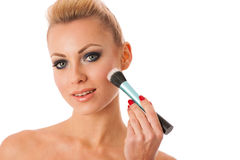 Portrait of woman holding beauty accessories, mascara, pauder br Stock Images