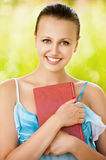 Portrait of woman holding a book at Stock Images