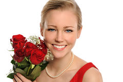 Portrait of Woman Holding Bouquet of Roses Royalty Free Stock Images