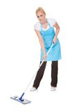 Portrait of woman holding broom Stock Photo