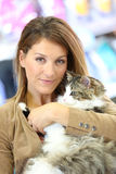 Portrait of woman holding cat in her arms Royalty Free Stock Image