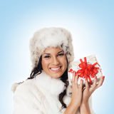 Portrait of a woman holding a Christmas present Stock Photo