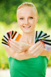 Portrait of woman holding colourful Royalty Free Stock Photos