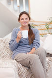 Portrait of a woman holding a cup of coffee Stock Images