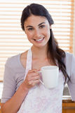 Portrait of a woman holding a cup of coffee Royalty Free Stock Photo