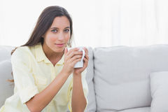 Portrait of a woman holding a cup of coffee Stock Photos