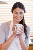 Portrait of a woman holding a cup of tea Royalty Free Stock Photos