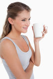 Portrait of a woman holding a cup of tea Stock Photos