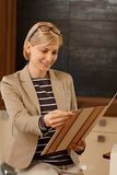 Portrait of woman holding folder Royalty Free Stock Images
