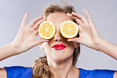 Portrait of woman, holding fresh lemon Stock Images