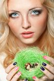 Woman holding nest with quail eggs Stock Photo