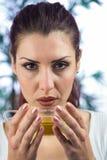 Portrait of woman holding herbal tea Stock Photo