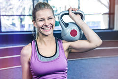 Portrait of woman holding kettlebell Royalty Free Stock Photos