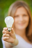 Portrait of woman holding lamp Stock Photo