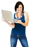 Portrait of woman holding laptop. Portrait of a young woman holding a laptop isolated over white royalty free stock photography