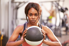 Portrait of a woman holding a medicine ball at a gym Royalty Free Stock Photos