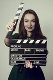Portrait woman holding a movie clapper Stock Photography