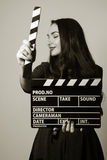 Portrait woman holding a movie clapper Royalty Free Stock Image